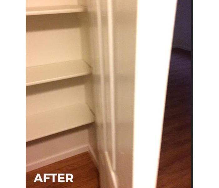 Hall way towel closet repaired from mold damage