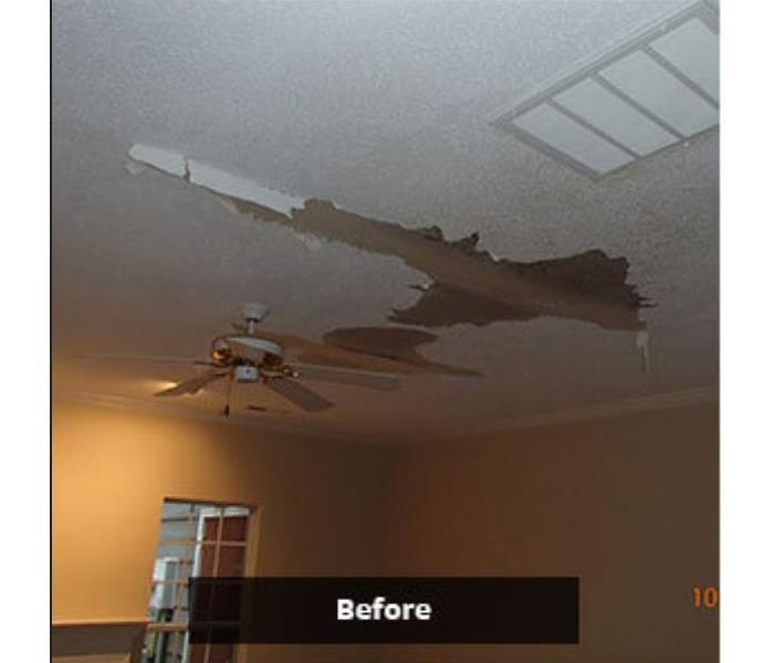 living area ceiling damaged by water